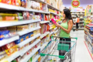 Woman checking food labeling